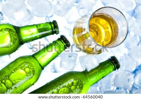 Three fresh beers with ice - stock photo