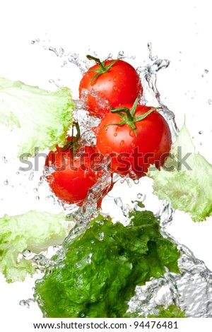 Three Fresh red Tomatoes and lettuce in splash water Isolated on white background - stock photo