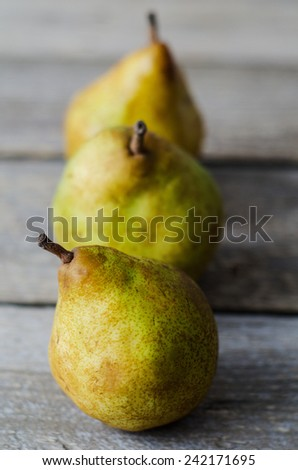 Three fresh ripe pears in a row - stock photo
