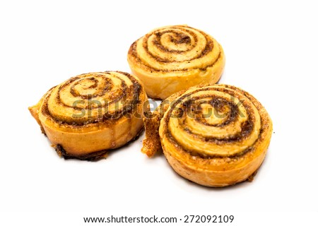 three fresh sweet homemade cinnamon rolls isolated on white background - stock photo