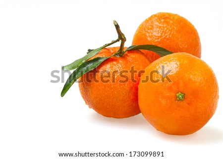 Three fresh tangerine on white background - stock photo