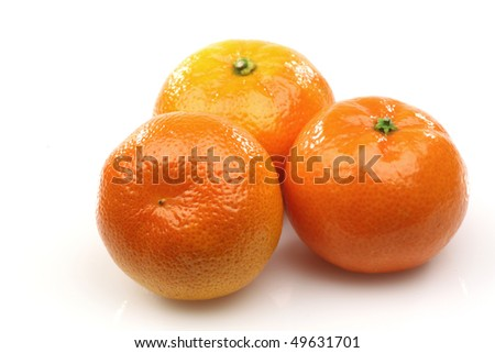 three fresh tangerines on a white background