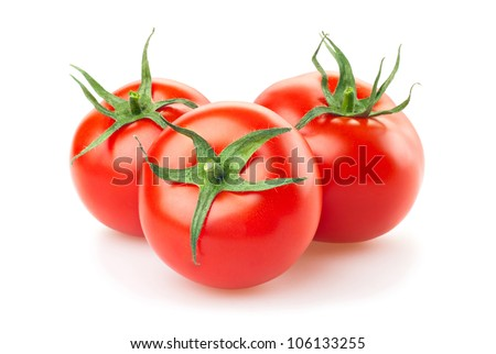 three fresh tomatoes with green leaves isolated on white background - stock photo