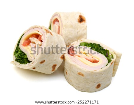 three fresh tortilla wraps with meat and vegetables