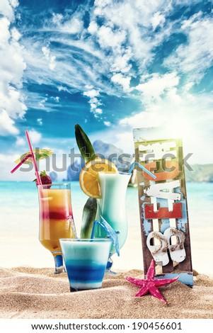 Three Fresh tropical cocktails on beautiful sunny beach - stock photo