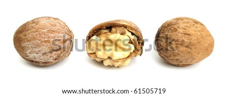 Three fresh walnuts in a row on the white background. One of them is crashed - stock photo