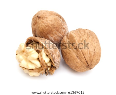 Three fresh walnuts on the white background. One of them is crashed - stock photo