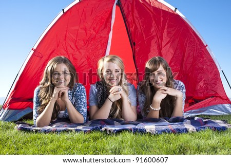 Three Friends Camping and Enjoying Outdoors - stock photo