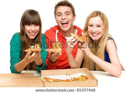 Three Friends Eating Pizza - stock photo