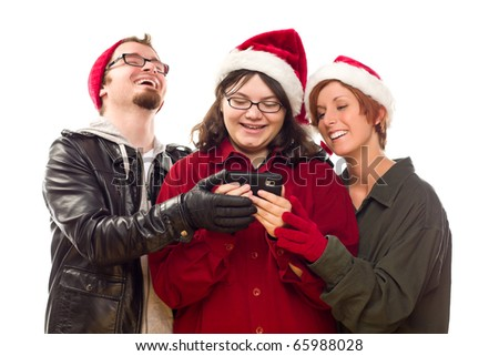 Three Friends Enjoying A Cell Phone Together Isolated on a White Background. - stock photo