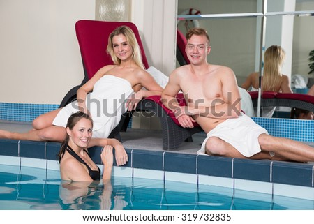 Three friends enjoying a day at the public hotel swimming pool