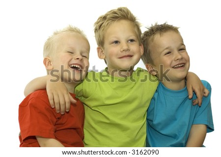Three friends laughing, holding each other and having fun. - stock photo