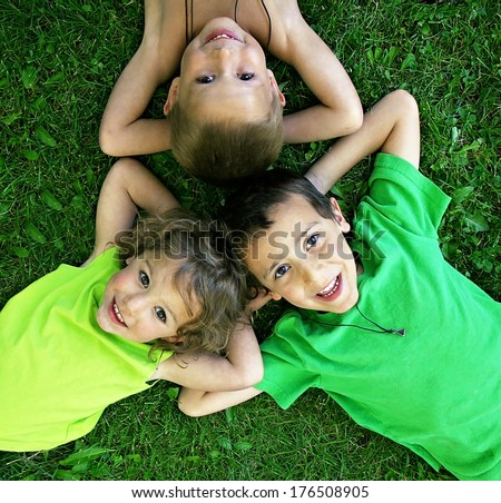 three friends laying in the grass