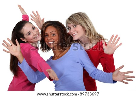 Three friends posing. - stock photo