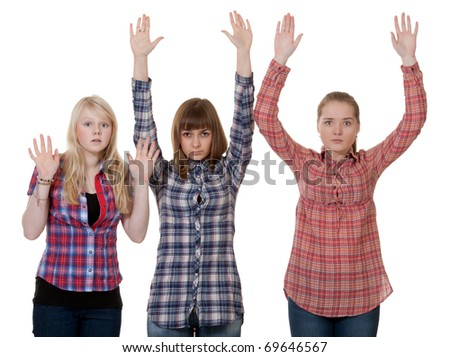 three friends raised their hands up on a white background - stock photo