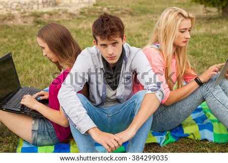 Three friends relaxing and having fun in park