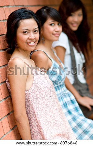 Three friends together outside having a good time