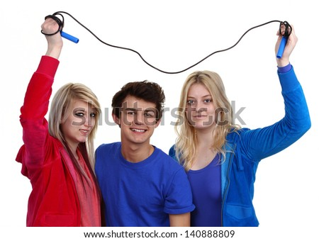 Three friends together with a skipping rope, isolated on white.
