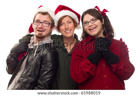 Three Friends Wearing Warm Holiday Attire Isolated on a White Background. - stock photo