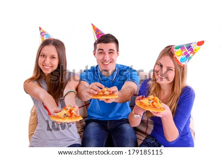 Three friends with pizza and hats - stock photo