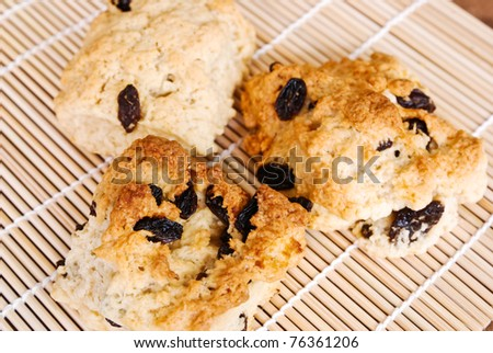 Three fruit scones currants  on a wooden