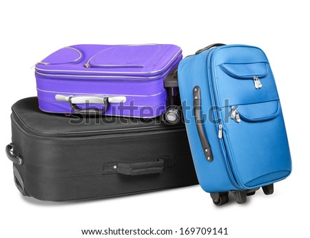 Three full and closed suitcases, black, blue and violet, ready for the trip, isolated on white background - stock photo