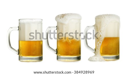 three full glasses of beer isolated on white background