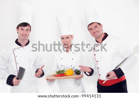 three funny chefs isolated on white - stock photo