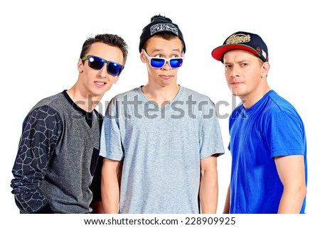 Three funny guys friends standing together. Different emotions. Isolated over white. - stock photo