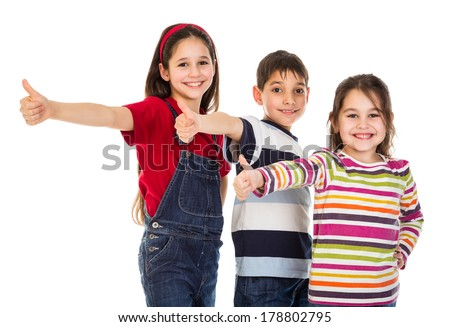 Three funny kids with thumbs up sign, isolated on white - stock photo