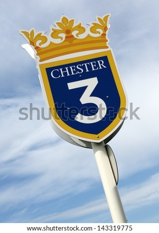 Three furlong sign at Chester Racecourse. - stock photo