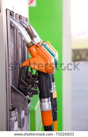 Three gas pump nozzles - stock photo