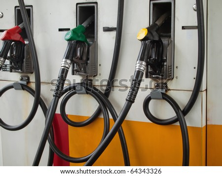 Three Gas Pump Nozzles at Gas Station Ready to work - stock photo