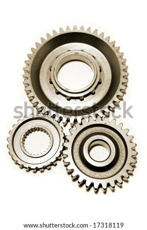 Three gears meshing together over white - stock photo