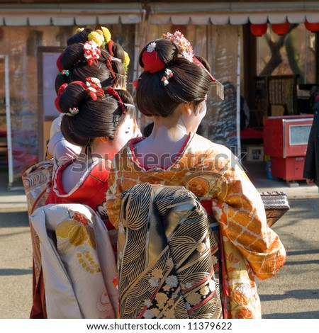 Three Geisha standing together at Kiyomizu temple in Kyoto, Japan - stock photo