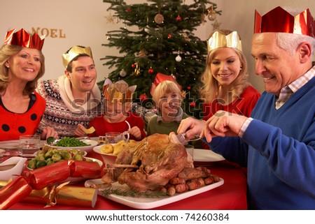 Three Generation Family Enjoying Christmas Meal At Home - stock photo