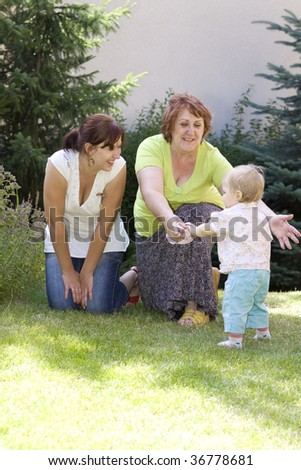 Three generation family in garden - stock photo
