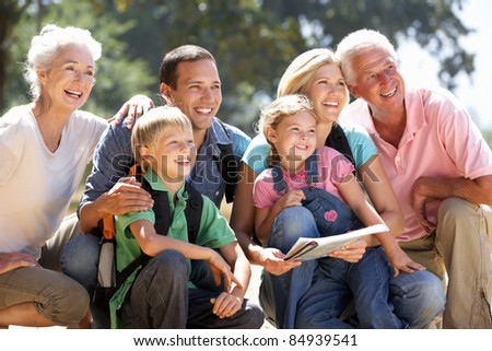 Three generation family on country walk - stock photo