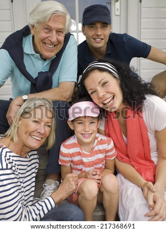 Three generation family portrait on veranda