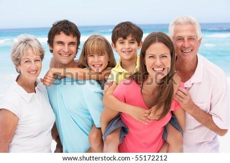 Three Generation Family Relaxing On Beach Holiday - stock photo