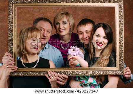 Three Generation Family Sitting On Sofa Together. Classic portrait in a frame - stock photo