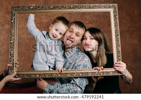 three generation family sitting on sofa together classic portrait in a frame