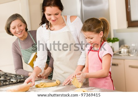 Three generation of happy women baking in kitchen prepare dough - stock photo