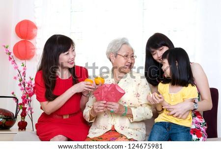three generations family celebrating chinese new year - stock photo