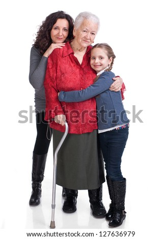 Three generations of women on a white background - stock photo