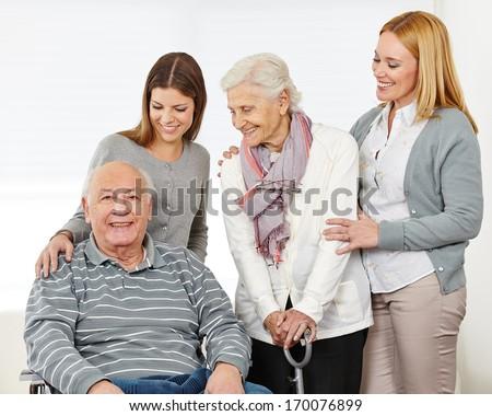 Three generations with happy senior couple at home - stock photo