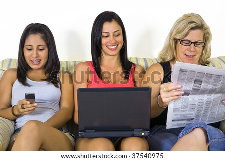 three generations woman reading the news - stock photo