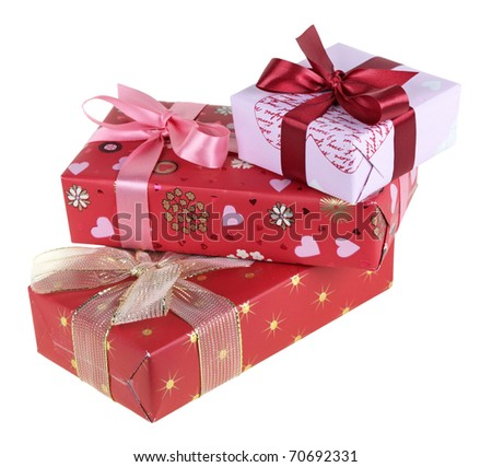 Three gift boxes which have been tied up by tapes with bows, isolated on a white background - stock photo