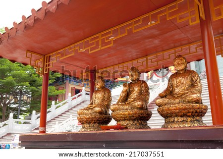 Three gild Buddha statues for buddhist offering - stock photo
