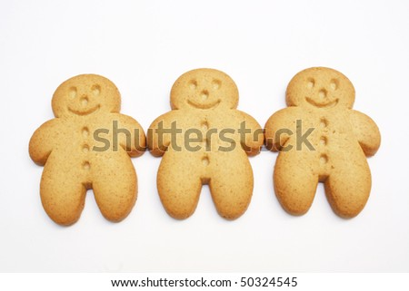 three gingerbread men isolated on white background